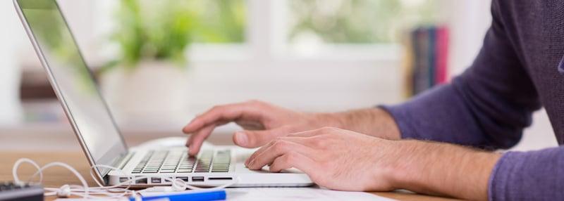 Guy at computer blog header